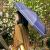 Hommy三つ折りの軽いボディに黒いゴムをつけて紫外線防止のパラソルを広げて水色を濃くします(F 3055PD)